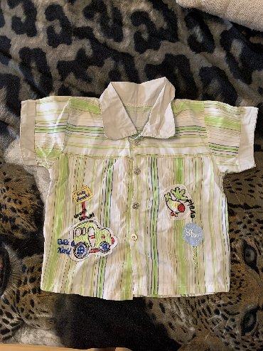 чемодан на колесах в Кыргызстан: Вещи на год - полтора на мальчика, шорты рубашка штанишки. Все за