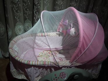 купить участок село байтик в Кыргызстан: Электронная люлька состояние хорошее, ребенок сам засыпает