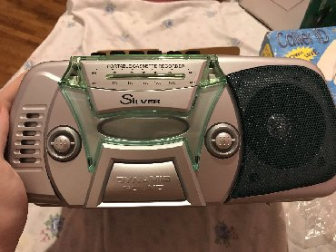 Silver portable radio cassette recorder. send me your offer