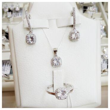 Стильные серебряные комплекты с покрытием драгоценного белого родия