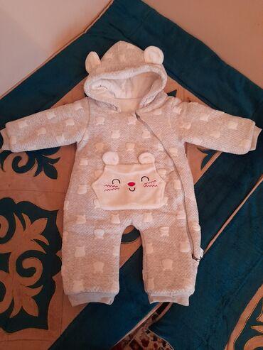 корейская одежда бишкек в Кыргызстан: Продаю теплый детский комбинезон в идеальном состоянии брала намного