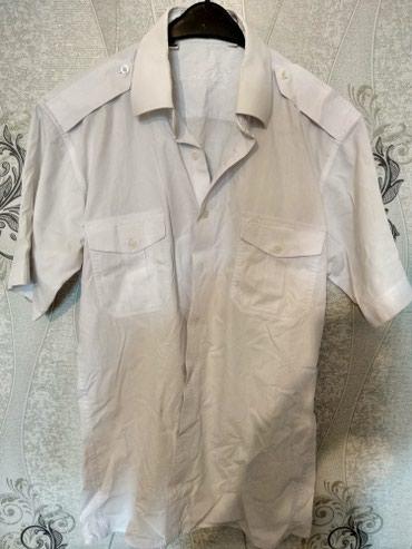 Рубашка-тенниска хлопчатобумажная куплена в Греции одевалась 2 или 3