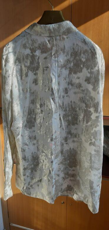 Продаю шикарную блузку 52 размер.привезли из США