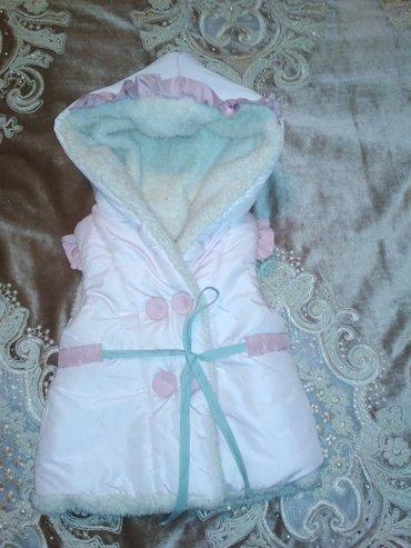 Продаю безрукавку детскую на 70 см очень тёплые красивую розового цвет в Токмак