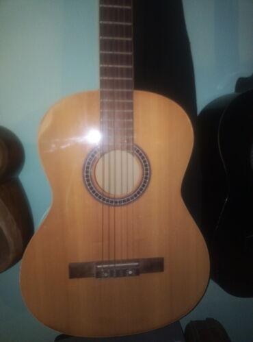 gitara i saksofon в Азербайджан: Gitara