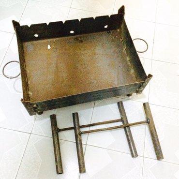 Bakı şəhərində Manqal - (teze)kabab ucun ayaqlari acilandir masinda ve elde dasinmasi