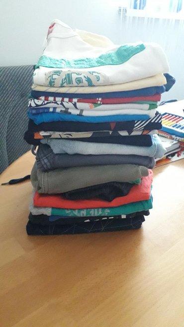 Paket stvari za 4-5 god.11 sorceva, i 11 majica ima i markiranih, sve