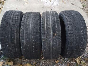 Продаю зимние шины бриджстоун близак в хорошем состоянии без порезов и