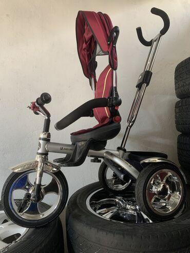 Продаю детскую коляску велосипед отличного качества покупали за 11000
