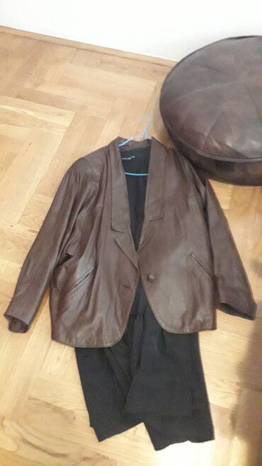 Braon,kozna jakna,bez ostecenja.Obucena par puta.Velicina l/xlRamena