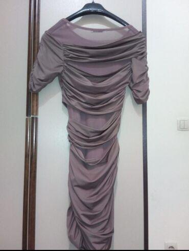 Prelepa kvalitetna haljina,vel. S,dosta se tegli i ide uz