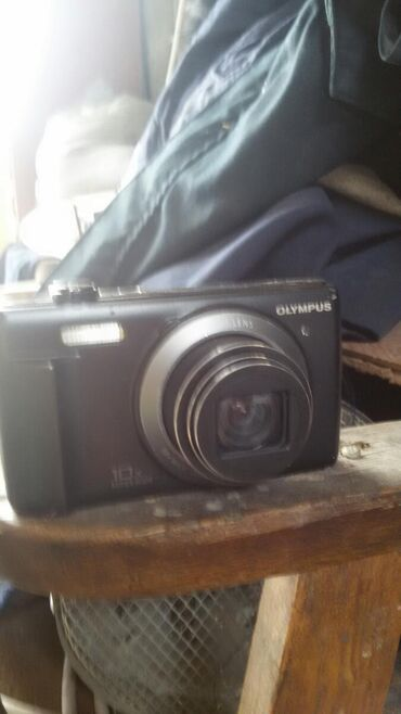 Фотоаппарат продам за 1000сом нужна зарядка адаптар