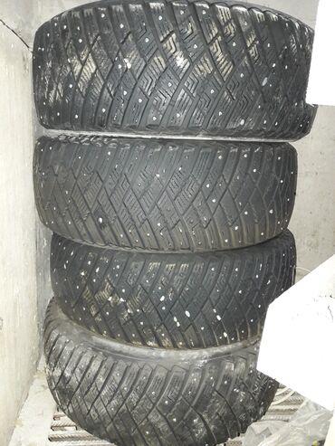 шины 215 55 17 в Кыргызстан: Продаю комплект зимних шин с шипами. Состояние хорошее. 215/55/17