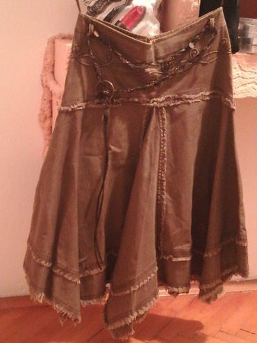 Suknja neobicnog kroja. Potrebno samo promeniti rajfislus. - Nis