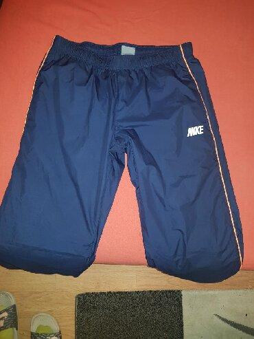 Sport i hobi - Zabalj: Nike suskava trenerka M velicina,dole skracena88 cm duzina od