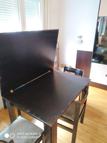 Trpezarijski sto na preklapanje sa četiri stolice