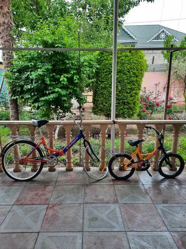 Hər ikisi işlənmiş velosipeddir. Böyük 24 - lükdür. Arxa təkəri kamerd