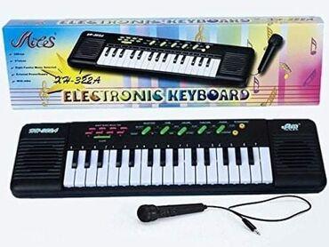 Tasne - Srbija: 1299dinKlavijatura Za Decu sa Mikrofonom (48 x 14cm)Ova elektronska i