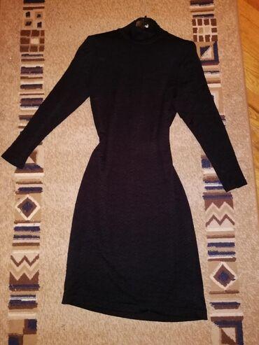 Haljina crna uska, prati figuru tela, vel. 42 razvlači se, cena 500