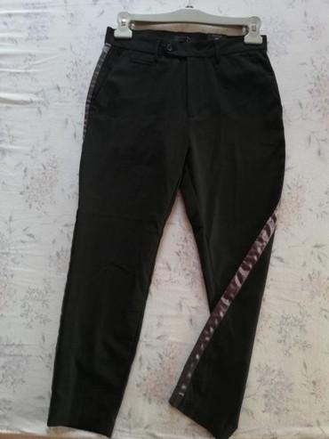 Poluobim-struka - Srbija: Prodajem nove muske Caliope cropped pantalone 42 velicina. Poluobim