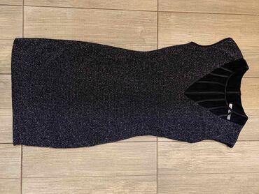Svetlucava haljina, nosena jednom
