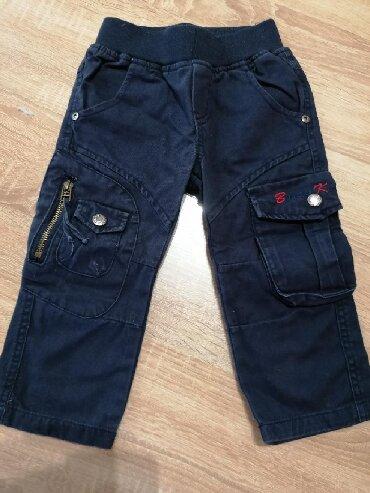 Pantalone sa na - Srbija: Deblje teget pantalone sa džepovima sa strane, gumom na struku,za