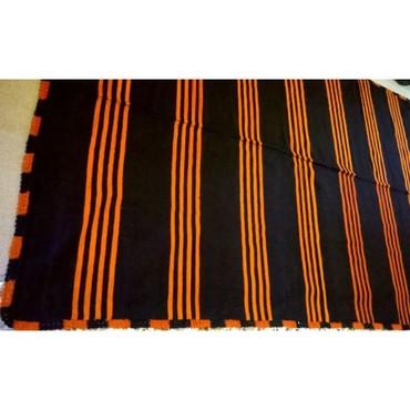 Υφαντή κουβέρτα πορτοκαλί και μπλε σε σε Athens