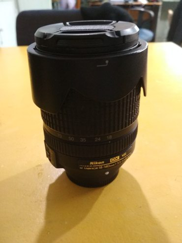 Продаю объектив nikon 18-140 в комплекте бленда фильтр крышки. в Бишкек