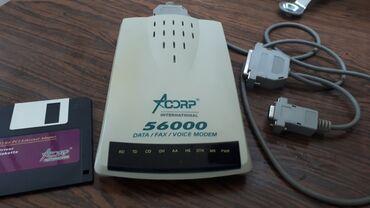 Транспорт - Бает: Аналоговый модем Acorp, нет адаптера