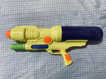 Oyuncaqlar Sumqayıtda: Su tapancasi. 60 sm  Водяной пистолет. 60 см
