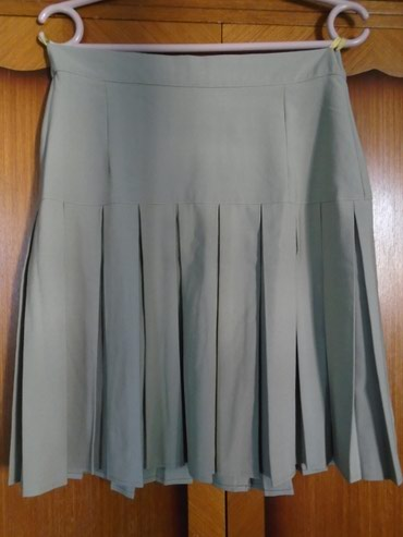 Suknjica C&A, veličine 40. Poluobim struka je38 cm a dužina - Belgrade