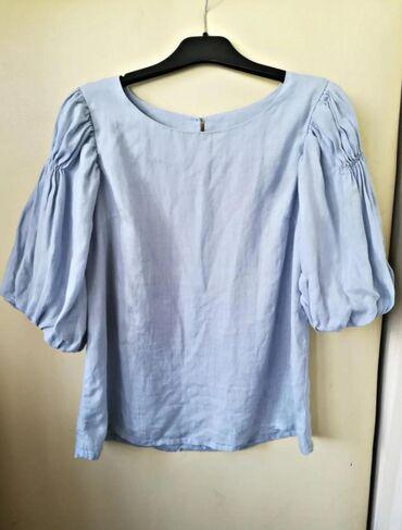 Очень красивая блуза с пышными рукавами, нежно-голубого цвета