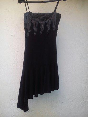 Ženska odeća | Kursumlija: Haljinica vel. S/MLepa crna uska haljina sa imitacijom zmijskog