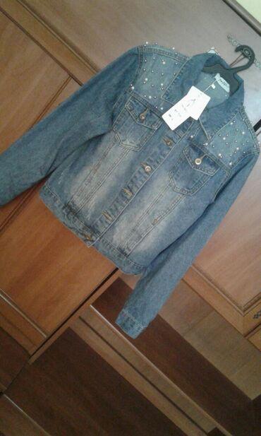 Молодёжная джинсовкаНовая в этикеткахПривезли из России.Размер не
