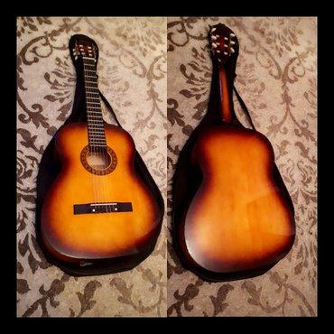 Bakı şəhərində Blazer firmasinin klassik gitarasi cantasi ile birge cemi 80azn