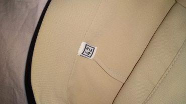 Pantalone-elegantne - Srbija: Prelepeelegantne pantalone, bez boje. velicina 42 moze zamena
