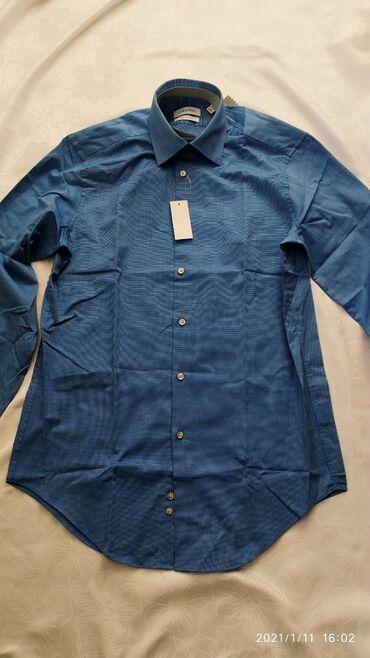 Продаю новую мужскую рубашкуОригинал от фирмы Calvin KleinЗаказывали