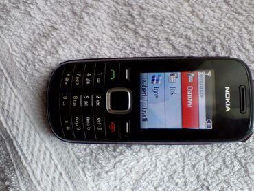 Mobilni telefoni - Kraljevo: Nokia 1661 na Telenor mreži sa originalnim punjacem