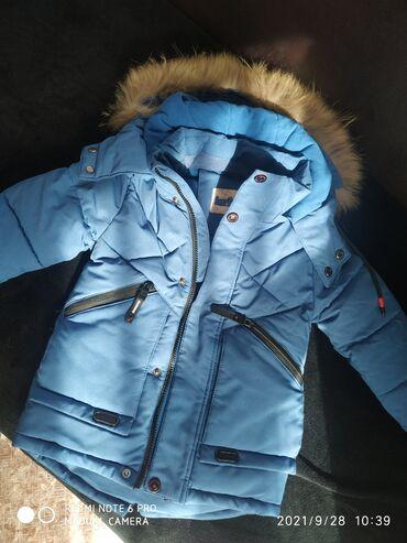 Продаю куртку. Зимняя. С капюшоном. Мех натуральный. Очень теплая. На