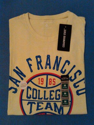 Muska majica,svetlo zuta sa natpisom,marka Primark,velicina M,vrhunski - Nis