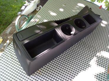 Auto delovi - Srbija: Plastika sa držačima za čaše za BMW x3