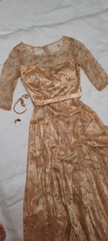 вечерние платья из люрекса в Кыргызстан: ПРОДАЁТСЯ ПЛАТЬЕ В ОТЛИЧНОМ СОСТОЯНИИ !!!!Платье золотистого цвета, из