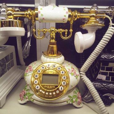 Klassik dizaynda ev telefonu.tam iwlekdir ve keyfiyyetlidir. seliqeli