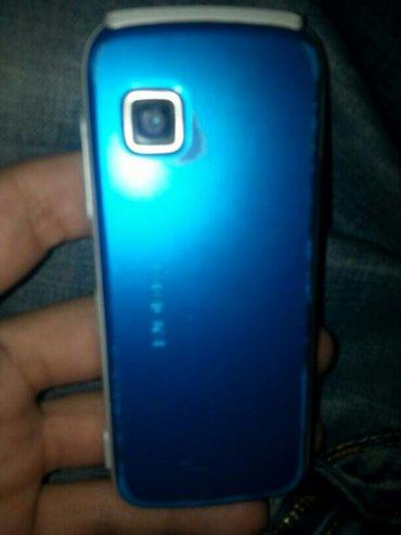 Bakı şəhərində Nokia 5230 ela veziyyetde iwleyir birce orta knobkasi gec cavab verir