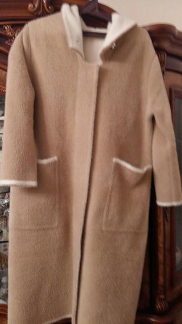 Sumqayıt şəhərində Anqorka orjinal dır.  baha alınıb. palto  ,  şuba əvəzi dir.
