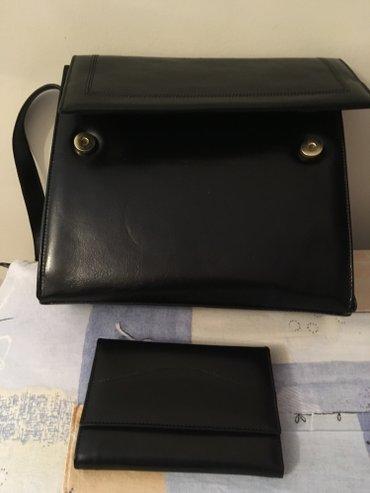 Nova kozna crna tasna i kozni crni novcanik u kompletu. Tasna ima tri - Belgrade