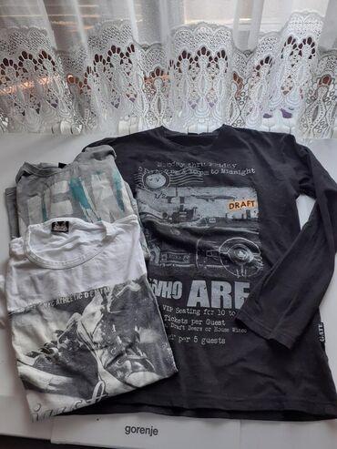 Muske majice,kao nove.Crna samo oprana,siva nosena 2 puta a bela je