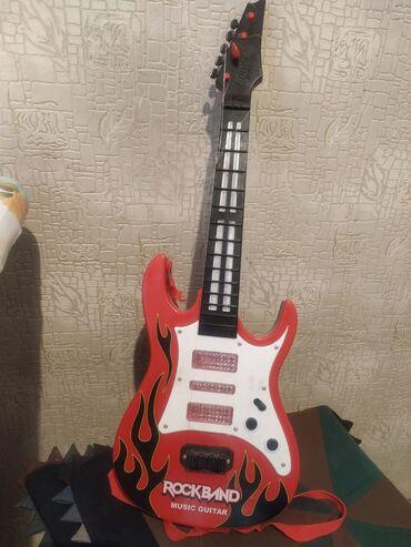 Гитара детская, светится, б/у, струны оторвались, находимся в 8 микр