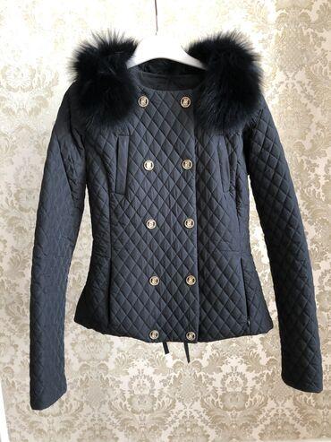 Стёганная куртка,со съемным мехом,турецкого производства. В хорошем со