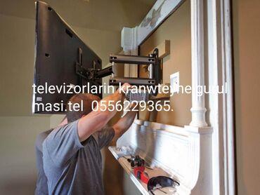 Televizorlarin kranwteyne gurulmasi. Установка телевизоров на